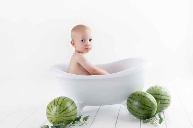 photography of baby on bathtub